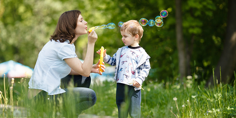 mother_son_blowing_bubbles_orchard_remedy's_rx_pharmacy_lung_awareness_COPD_disease